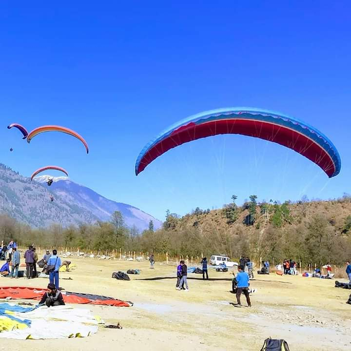 mountain view with paragliding
